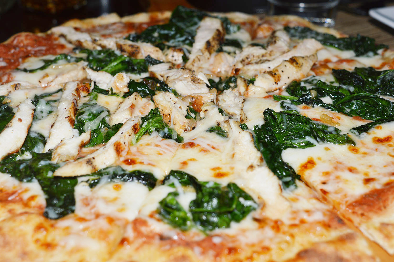 Chicken & Spinach Pizza - Photo Credit: thespotist.com